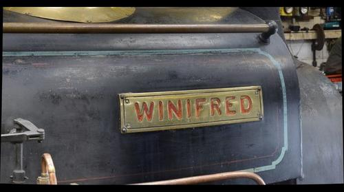 Winifred's driver's side nameplate