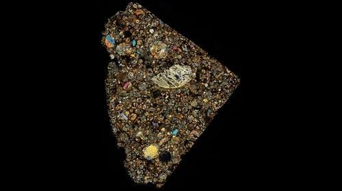 Chondrite meteorite (NWA 7308) thin section in cross polarised light