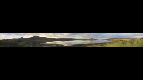 Loch Dunvegan, Isle of Skye, Scotland, taken in early morning and looking N.W.   Macleods Tables (the flat topped mountains) to the left and Dunvegan village to the right.