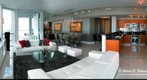 The Grand Room and Kitchen of a 3 Bedroom Apartment at the Vizcayne Condos in Miami, Florida