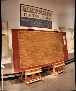 Hoboken Historical Museum - Mapping the Territory: Hudson County in Maps, 1840-2013, Jan. - Sept. 2013, Entry title & 1854 map.