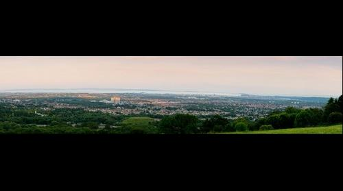 Panoramic view across Cardiff at dusk.