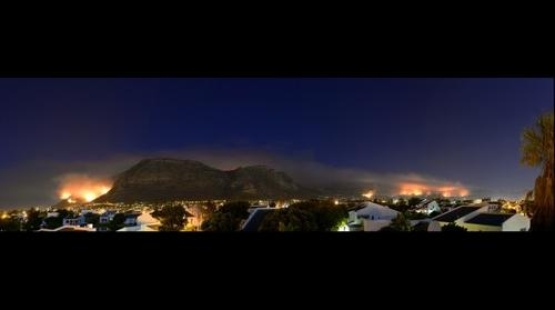 Muizenberg at night with raging wild fire