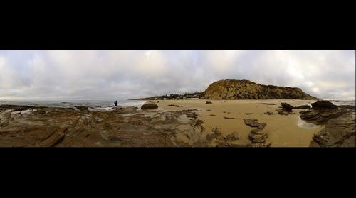 Man Photographing the Ocean with his iPhone