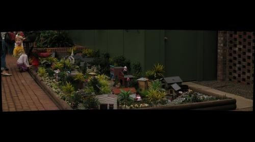 Model train layout and kids at Phipps Conservatory