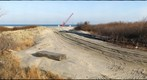 Crane on beach for dredging project, Gunnison Beach, Sandy Hook, NJ, USA