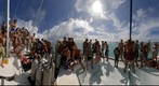 Lots of Odyssey Expeditions students on front of Moorings catamaran in the Tobogo Keys, Grenadines