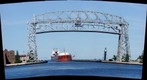 Duluth Minnesota Aerial Lift Bridge with Ore Boat Arrival
