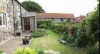 GP91 Howburn Farmhouse Northumberland. Front Garden