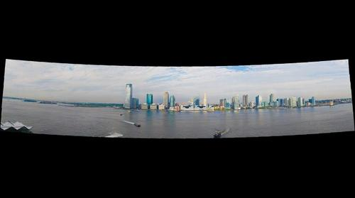Jersey City skyline, Hudson River and Statue of Liberty  shot from Manhattan New York