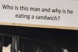 Who is this man and why is he eating a sandwich?