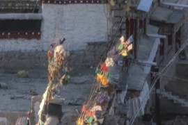 Sunset lit prayer flags