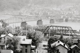 The old Monongahela Bridge and the Pennsylvania Railroad bridge