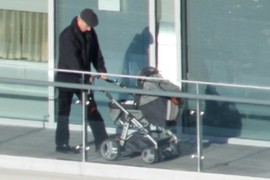 Man with Baby Stroller